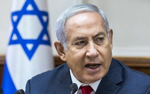 Prime Minister Benjamin Netanyahu speaks during the weekly cabinet meeting at his office in Jerusalem on August 12, 2018. (AFP Photo/Pool/Jim Hollander)