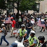 Police escort far-right demonstrators during a rally at Lafayette Park opposite the White House August 12, 2018 in Washington, DC, one year after the deadly violence at a similar protest in Charlottesville, Virginia.    (AFP / Nicholas Kamm)