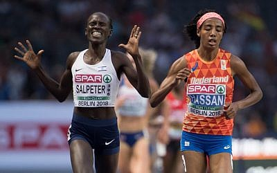 Israel's Lonah Chemtai Salpeter (L), thinking the race was over, celebrates as she runs next to Netherlands' Sifan Hassan, although one lap was still to go, during the women's 5000m final race at the European Athletics Championships at the Olympic stadium in Berlin on August 12, 2018. (AFP PHOTO / DPA / Sven Hoppe)
