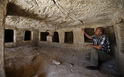Taleb Jubran, director of the department of tourism and antiquities in Hebron, points to an ancient burial site from the Roman-era which was discovered during construction of a new road in the southern West Bank village of Idna on August 16, 2018. (AFP Photo/Hazem Bader)