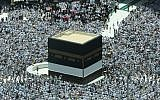 Muslim worshipers pray around the Kaaba, Islam's holiest shrine, at the Grand Mosque in Saudi Arabia's holy city of Mecca on August 16, 2018, prior to the start of the annual hajj pilgrimage in the holy city. (AFP/Ahmad Al-Rubaye)