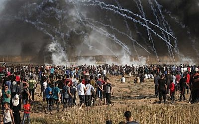 Illustrative: A picture taken on August 17, 2018 shows tear gas canisters thrown by Israeli forces at Palestinian protesters during a demonstration along the border of the Gaza Strip, east of Gaza City (AFP PHOTO / MAHMUD HAMS)
