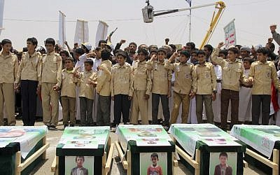 In this file photo taken on August 13, 2018 Yemeni children vent anger against Riyadh and Washington as they take part in a mass funeral in the northern Yemeni city of  Saada, a stronghold of the Iran-backed Huthi rebels, for children killed in an air strike by the Saudi-led coalition last week. (AFP PHOTO / STRINGER)