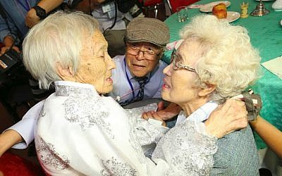 South Koreans Jo Hye-do (R), 86, and Jo Do-jae (C), 75, meet their North Korean sister Jo Soon Do (L), 89, during a separated family reunion meeting at the Mount Kumgang resort on the North's southeastern coast on August 20, 2018. (AFP PHOTO / KOREA POOL)