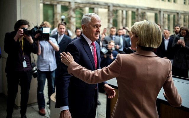 Australia's Malcolm Turnbull, center, and  Julie Bishop, right, leave after a press conference in Canberra on August 21, 2018. (AFP / SEAN DAVEY)