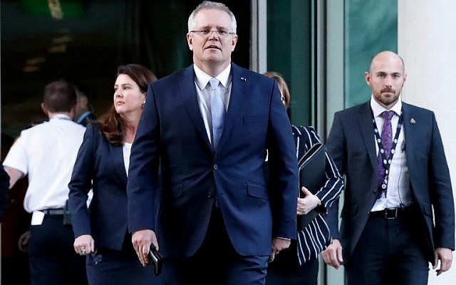 Australia's Scott Morrison arrives for a party meeting in Canberra on August 24, 2018. (AFP/ POOL / DAVID GRAY)