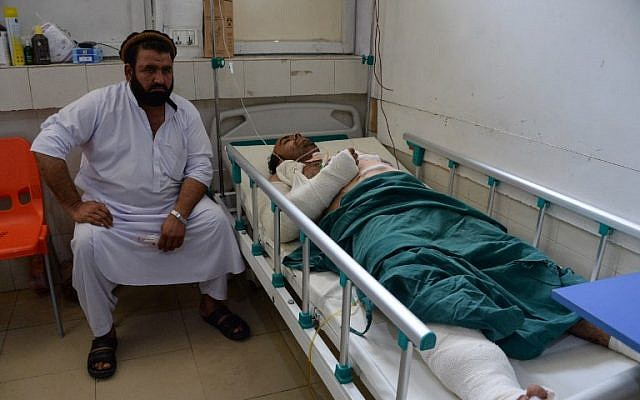 An Afghan victim receives treatment at a hospital following a suicide attack in Jalalabad on August 25, 2018. (AFP PHOTO / NOORULLAH SHIRZADA)