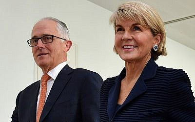 This file photo taken on August 24, 2018 shows Australia's Foreign Minister Julie Bishop (R) walking with Australia's incumbent Prime Minister Malcolm Turnbull after a party meeting in Canberra. (AFP PHOTO / SAEED KHAN)