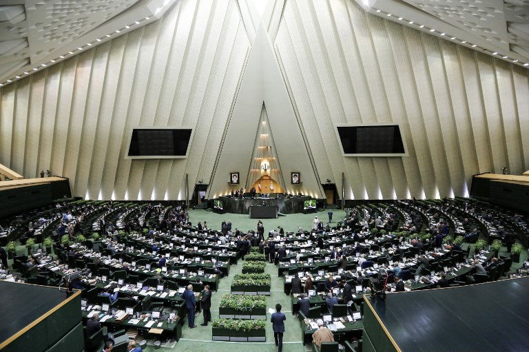 Iran parliament rejects Rouhani's economic plans as hardline rivals gain clout