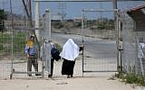 Palestinians are seen crossing at the Erez crossing with Israel near Beit Hanoun in the northern Gaza Strip on  August 27, 2018. (AFP/Mahmud Hams)