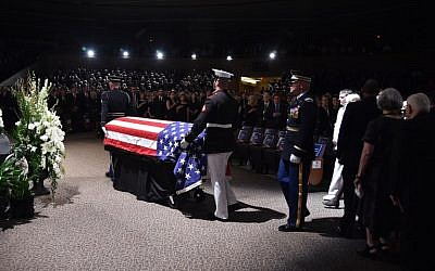 The flag-draped casket of the late US Senator John McCain arrives at the North Phoenix Baptist Church for the memorial service honoring McCain, August 30, 2018 in Phoenix, Arizona.   (AFP / Robyn Beck)