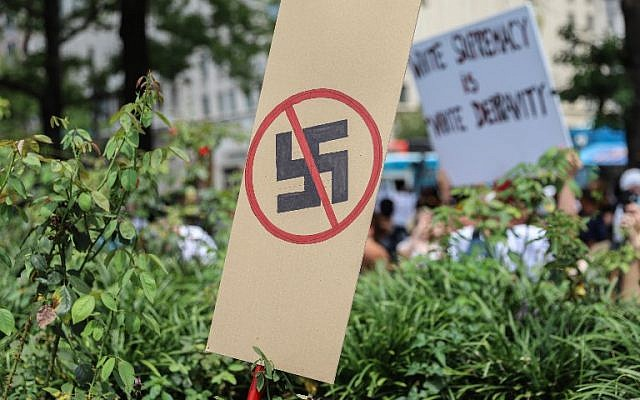 A anti-Nazi sign stands as counter protesters gather at Freedom Plaza before the Unite the Right rally in Lafayette Park on August 12, 2018 in Washington, DC. (Virginia.  Alex Wroblewski/Getty Images/AFP)