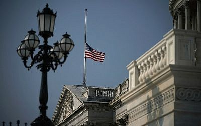 An American flag at the U.S. Capitol flies at half staff August 27, 2018 in Washington, DC. Sen. John McCain (R-AZ), a decorated American war hero, died August 25, 2018 at the age of 81, after a long battle with brain cancer.  ( Alex Wong/Getty Images/AFP)