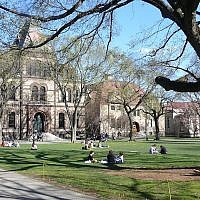 Students sitting in the College Green outside Sayles Hall on the Brown University campus in Providence, Rhode Island. (Wikimedia Commons via JTA)