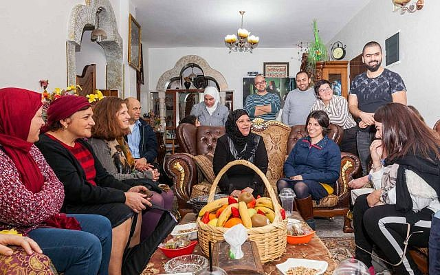 Participants of the Teachers' Lounge coexistence project at the home of an Arab participant in East Jerusalem. (Courtesy: Eyal Tagar)