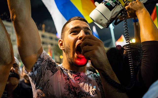 Protesters at a demonstration in Tel Aviv against the nation-state law, on August 4, 2018. (Luke Tress / Times of Israel staff)