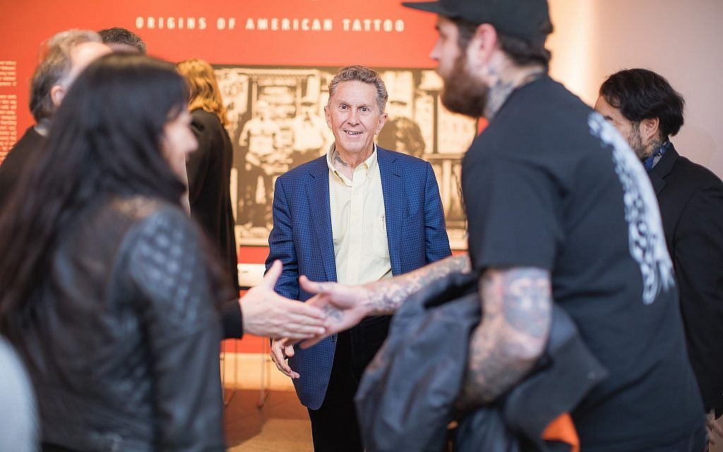 Renowned tattoo artist Don Ed Hardy, back center, at the installation Lew the Jew and His Circle: Origins of American Tattoo. On view July 26, 2018–June 9, 2019 at The Contemporary Jewish Museum, San Francisco. (Gary Sexton Photography)