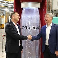 SodaStream CEO Daniel Birnbaum (l) and PepsiCo's CEO Ramon Laguarta at the SodaStream factory in Israel's Negev Desert next to the city of Rahat on August 20, 2018. (Eliran Avital)