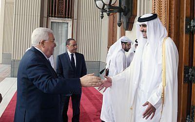 Palestinian Authority President Mahmoud Abbas meets with Qatari Emir Tamim bin Hamad Al Thani in Doha on August 9, 2018. (Wafa/Thaer Ghnaim)