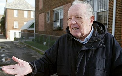 Jakiw Palij, a former Nazi concentration camp guard, stands in front of a building in the Queens borough of New York, November 20, 2003. (Suzanne DeChillo/The New York Times via AP)