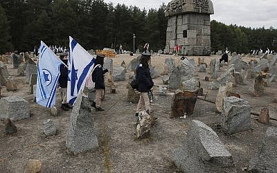 Israeli youths march by the monument to some 900,000 European Jews killed by the Nazis between 1941 and 1944 at the Treblinka death and labor camp, at Treblinka memorial, Poland on October 2, 2013. (AP Photo/Czarek Sokolowski)