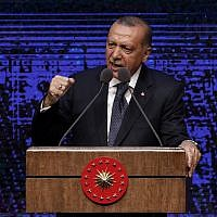 Turkey's President Recep Tayyip Erdogan announces plan of action for the first 100 days of his new presidency, in Ankara, Turkey, Friday, Aug. 3, 2018. (AP/Burhan Ozbilici)