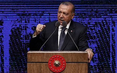 Turkey's President Recep Tayyip Erdogan announces plan of action for the first 100 days of his new presidency, in Ankara, Turkey, Friday, August 3, 2018. (AP/Burhan Ozbilici)