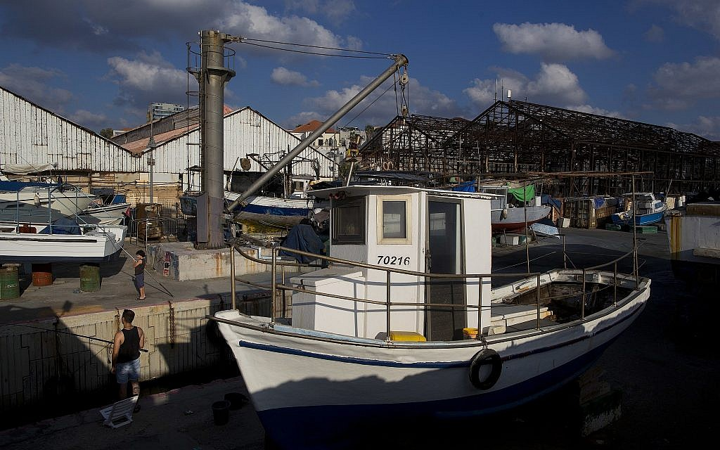 In this photo from July 21, 2018, fisherman cast their rods in the port of Jaffa. (AP Photo/Oded Balilty)