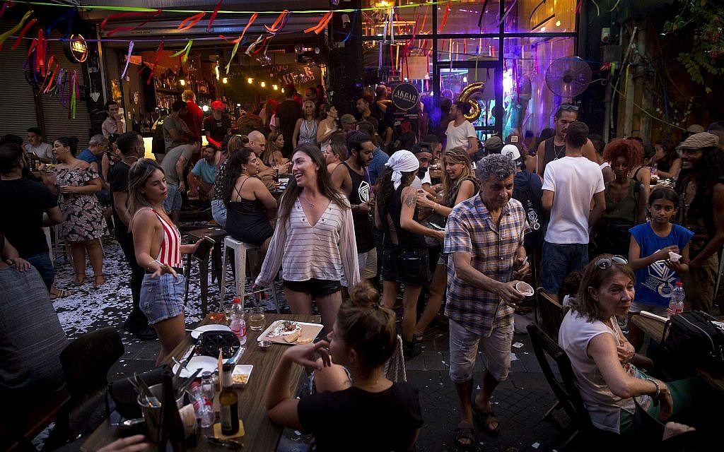In this photo from July 28, 2018, people dance in Akbar, a bar located in the flea market in Jaffa. (AP Photo/Oded Balilty)