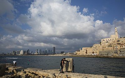 In this photo from July 28, 2018, fisherman cast their rods in the port of Jaffa. (AP Photo/Oded Balilty)