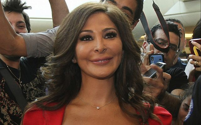 In this July 13, 2012, photo, Lebanese diva Elissa, whose real name is Elissar Khoury, one of the best known and highest-selling female artists in the Arab world, poses for photographers, in Beirut, Lebanon. (AP Photo)