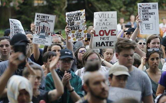 Demonstrators march on the campus of the University of Virginia in anticipation of the anniversary of last year's Unite the Right rally in Charlottesville, Va., Saturday, Aug. 11, 2018. (AP/Steve Helber)