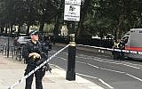 Police patrol on Millbank, in central London, after a car crashed into security barriers outside the Houses of Parliament, in London, Tuesday, Aug. 14, 2018.  (Sam Lister/PA via AP)