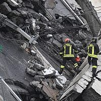 Rescues work among the rubble of the collapsed Morandi highway bridge in Genoa, northern Italy, August 14, 2018. (Luca Zennaro/ANSA via AP)