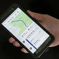 In this August 8, 2018, photo a mobile phone displays a user's travels using Google Maps in New York. (AP Photo/Seth Wenig)