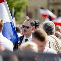 An Adolf Hitler lookalike attends a demonstration commemorating the 31st anniversary of the death of Hitler's deputy Rudolf Hess, in Berlin Saturday, Aug 18, 2018. Hess died 1987 in a prison in Berlin. (Christoph Soeder/dpa via AP)