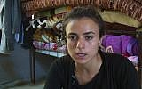 19-year-old Yazidi refugee, Ashwaq Haji Hami talks about her experiences in Germany, saying she has now returned to her homeland of Iraq for fear that her alleged Islamic State tormentor could harm her in Germany, during an interview at Essian refugee camp in Iraq, August 17, 2018. (AP Photo)