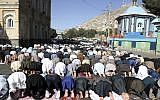 Men attend Eid al-Adha prayers outside of the Shah-e-Dushamshera mosque in Kabul, Afghanistan, August 21, 2018. (Rahmat Gul/AP)