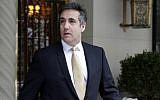 Michael Cohen, former personal lawyer to US President Donald Trump, leaves his apartment building, in New York, Tuesday, August 21, 2018. (AP Photo/Richard Drew)