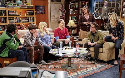 "This image released by CBS shows Kunal Nayyar, from left, Simon Helberg, Melissa Rauch, Jim Parsons, Mayim Bialik, Johnny Galecki and Kaley Cuoco appear in a scene from the long-running comedy series ""The Big Bang Theory."" (Erik Voake/CBS via AP)"