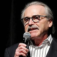 David Pecker, Chairman and CEO of American Media, addresses those attending the Shape and Men's Fitness Super Bowl Party in New York in 2014. (Marion Curtis/AP)