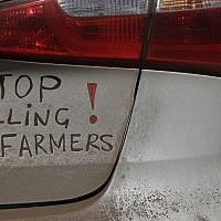 In this photo from October 30 2017, a bumper sign calls for the end of farm killings in South Africa, during a blockade of a freeway in Midvaal, South Africa. (AP Photo/Themba Hadebe, File)
