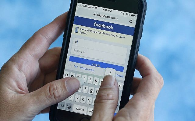 In this file photo dated August 21, 2018, a Facebook start page is shown on a smartphone in Surfside, Florida, USA. (AP Photo/Wilfredo Lee, FILE)