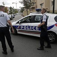 Police officers stand guard after a knife attack August 23, 2018 in Trappes, west of Paris. (AP Photo/Michel Euler)