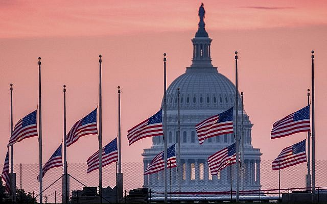 White House flags back up after McCain death