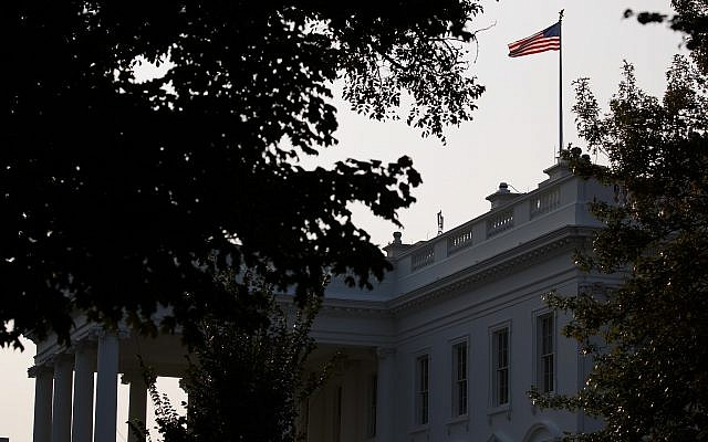 An American flag above the White House flies at full-staff less than 48 hours after the death of Sen. John McCain, August 27, 2018, in Washington, DC. (AP Photo/Evan Vucci)