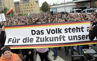People gather for a far-right demonstration in Chemnitz, Germany, Thursday, Aug. 30, 2018. (AP/Jens Meyer)