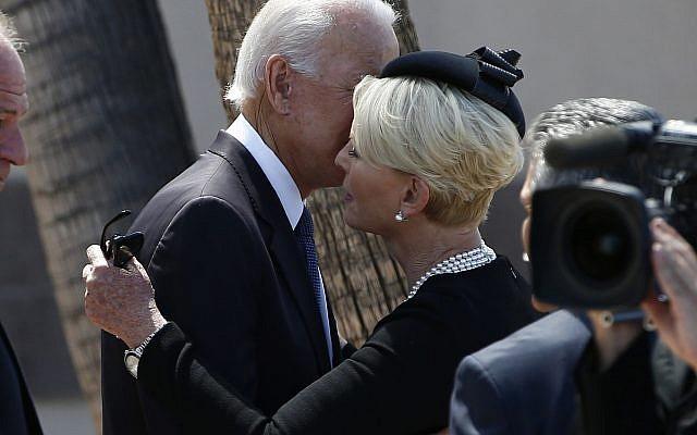 Cindy McCain, right, wife of Sen. John McCain, R-Ariz., gets a hug from former Vice President Joe Biden, left, after a memorial service for McCain at North Phoenix Baptist Church Thursday, Aug. 30, 2018, in Phoenix. (AP/Ross D. Franklin)