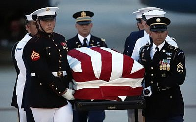 The flag-draped casket of Sen. John McCain, R-Ariz., is carried by an Armed Forces body bearer team to a hearse, Thursday, Aug. 30, 2018, at Andrews Air Force Base, Md. (AP/Alex Brandon)