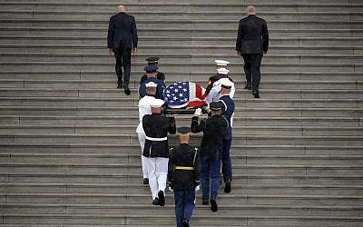The flag-draped casket of Sen. John McCain, R-Ariz., is carried up the steps of the US Capitol, Friday, Aug. 31, 2018, in Washington. (Photo by John McDonnell/The Washington Post via AP, Pool)